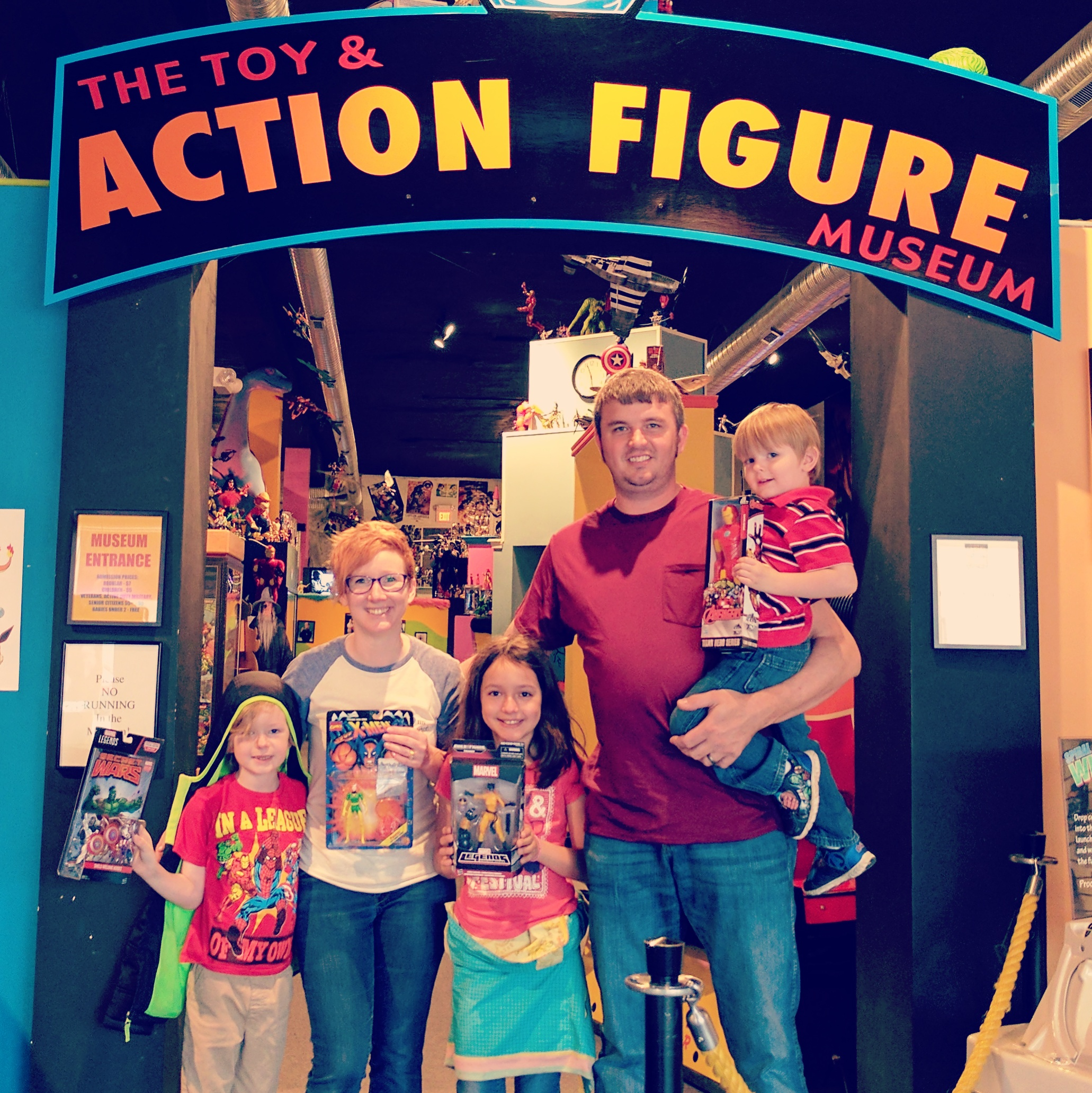 Social Media Consultant and Copywriting Crystal Moreland with her husband and three children at The Toy and Action Figure Museum in Pauls Valley, OK